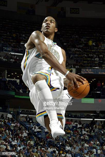 R Smith of the New Orleans Hornets flys in for a dunk against the Los Angeles Clippers on April 20 2005 at the New Orleans Arena in New Orleans...