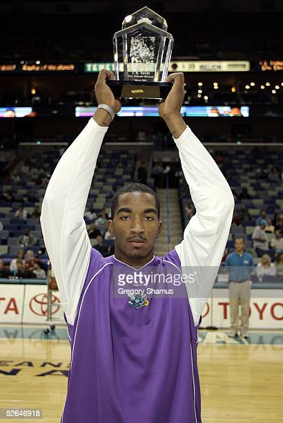 R Smith of the New Orleans Hornets recieves the rookie of the month award for the month of March at the New Orleans Arena on April 18 2005 in New...