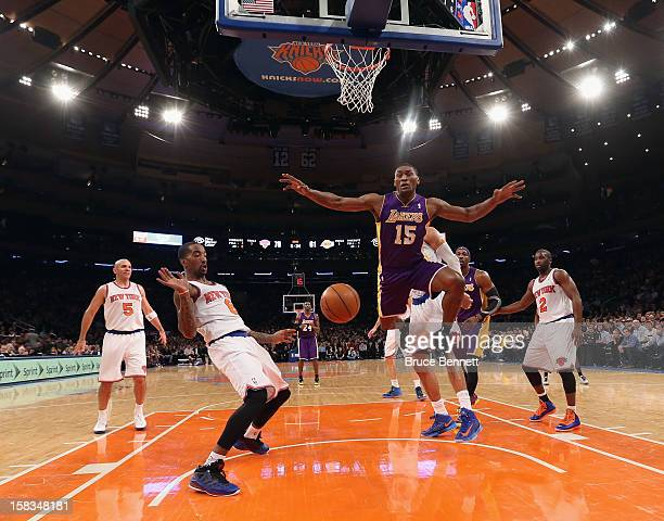 R Smith of the New York Knicks and Metta World Peace of the Los Angeles Lakers battle for a loose ball at Madison Square Garden on December 13 2012...