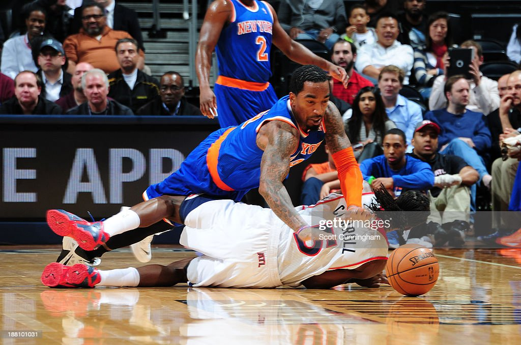 J.R. Smith #8 of the New York Knicks battles for a loose ball against the Atlanta Hawks on November 13, 2013 at Philips Arena in Atlanta, Georgia.