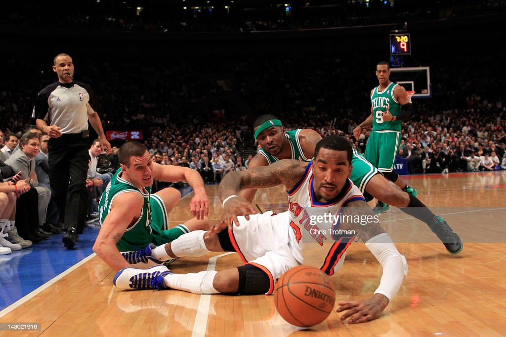 J.R. Smith #8 of the New York Knicks battles for a loose ball with Sasha Pavlovic #11 of the Boston Celtics and Keyon Dooling #51 of the Boston Celtics at Madison Square Garden on April 17, 2012 in New York City.