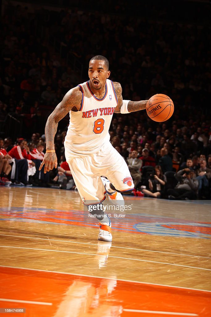 J.R. Smith #8 of the New York Knicks brings the ball up court against the Washington Wizards on November 30 2012 at Madison Square Garden in New York City.