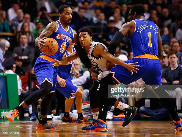 R Smith of the New York Knicks carries the ball in front of a screened Phil Pressey of the Boston Celtics in the first quarter during the game at TD...
