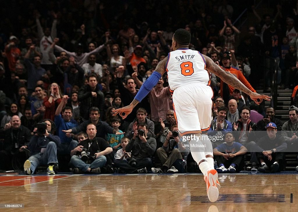 J.R. Smith #8 of the New York Knicks celebrates against the Dallas Mavericks on February 19, 2012 at Madison Square Garden in New York City. The Knicks defeated the Mavericks 104-97.