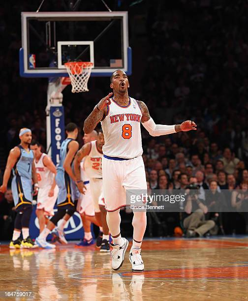 R Smith of the New York Knicks celebrates his three pointer in the second quarter against the Memphis Grizzlies at Madison Square Garden on March 27...