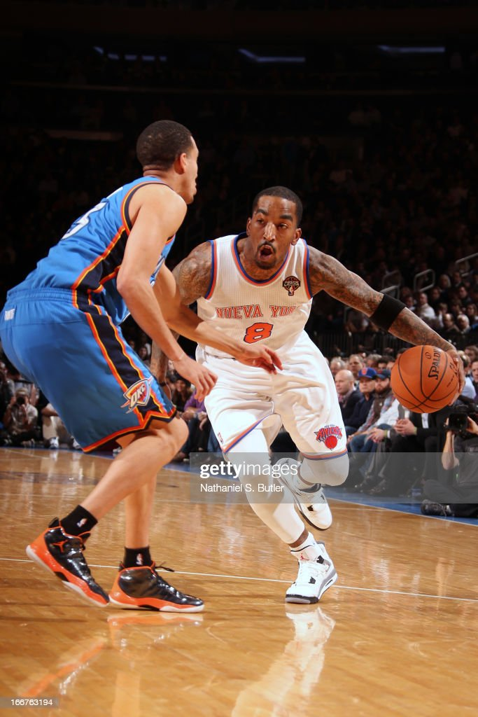 J.R. Smith #8 of the New York Knicks drives against Kevin Martin #23 of the Oklahoma City Thunder on March 7, 2013 at Madison Square Garden in New York City.
