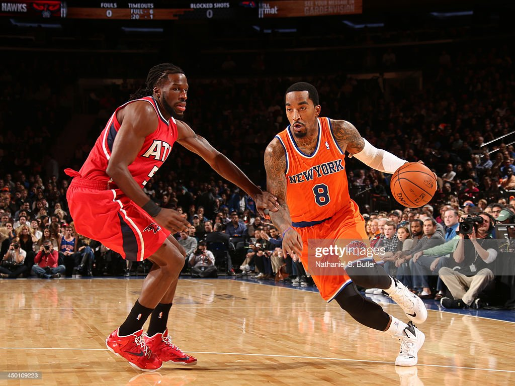 J.R. Smith #8 of the New York Knicks drives during a game against the Atlanta Hawks at Madison Square Garden in New York City on November 16, 2013.
