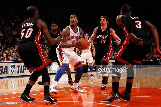 ecbad81000f R Smith of the New York Knicks drives in the first half against Joel  Anthony LeBron. Miami Heat ...