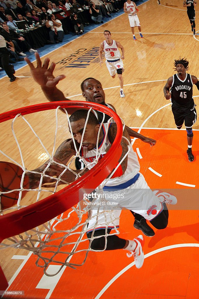 J.R. Smith #8 of the New York Knicks drives to the basket against Andray Blatche #0 of the Brooklyn Nets on December 19, 2012 at Madison Square Garden in New York City.