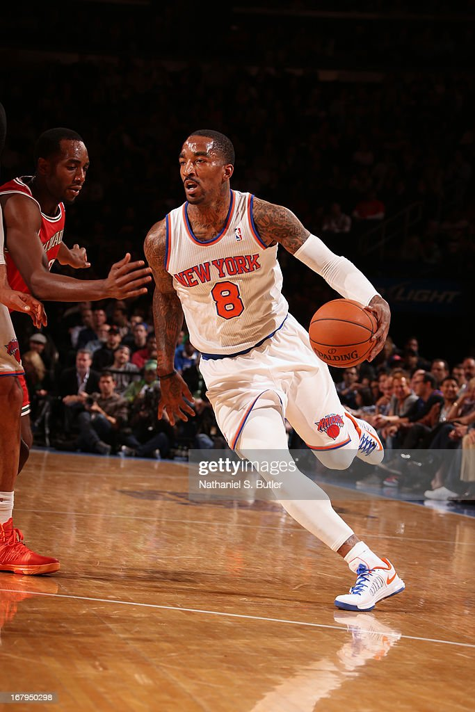 J.R. Smith #8 of the New York Knicks drives to the basket against the Milwaukee Bucks on April 5, 2013 at Madison Square Garden in New York City.