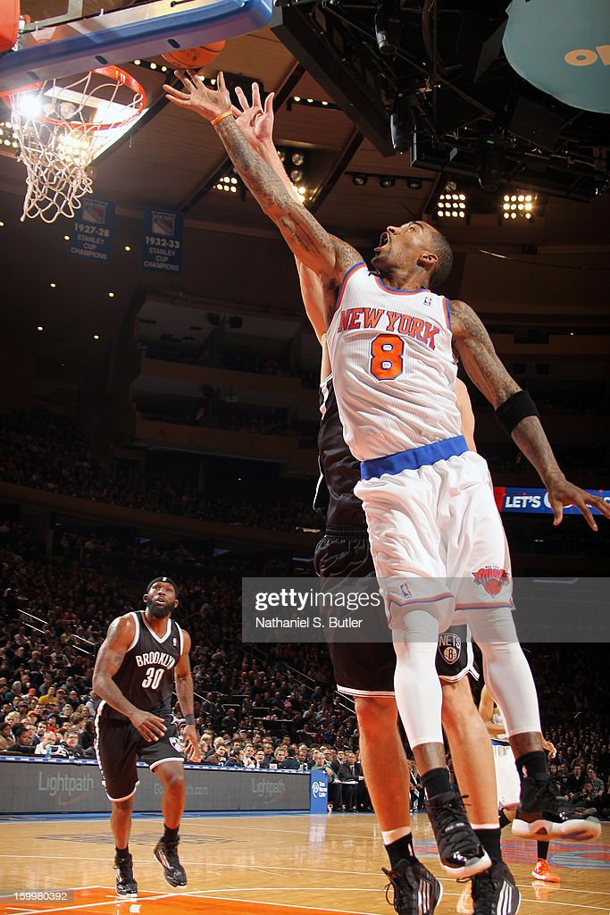 J.R. Smith #8 of the New York Knicks drives to the basket against the Brooklyn Nets on January 21, 2013 at Madison Square Garden in New York City.