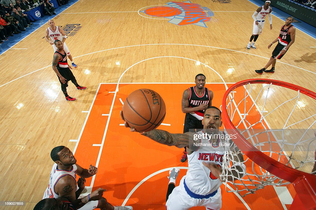 J.R. Smith #8 of the New York Knicks drives to the basket against the Portland Trail Blazers on January 1, 2013 at Madison Square Garden in New York City.