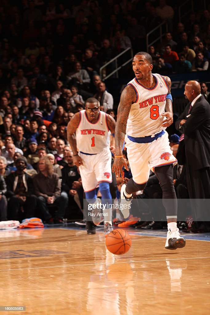 J.R. Smith #8 of the New York Knicks drives up-court against the Milwaukee Bucks on February 1, 2013 at Madison Square Garden in New York City .