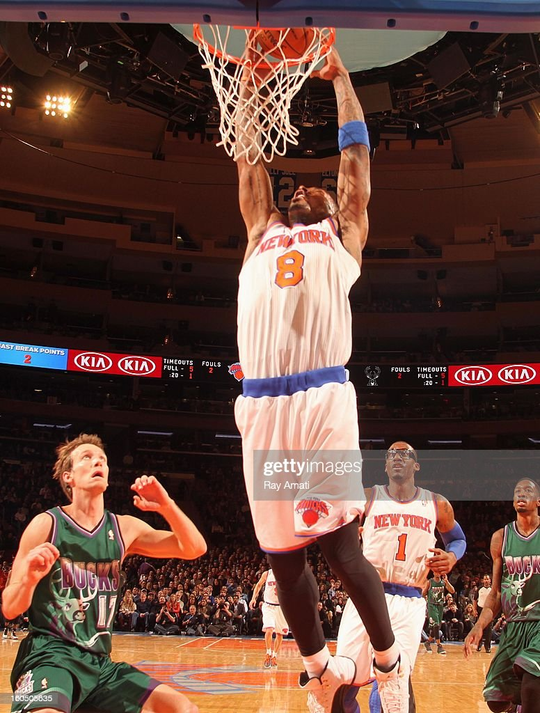J.R. Smith #8 of the New York Knicks dunks against Mike Dunleavy #17 of the Milwaukee Bucks on February 1, 2013 at Madison Square Garden in New York City .
