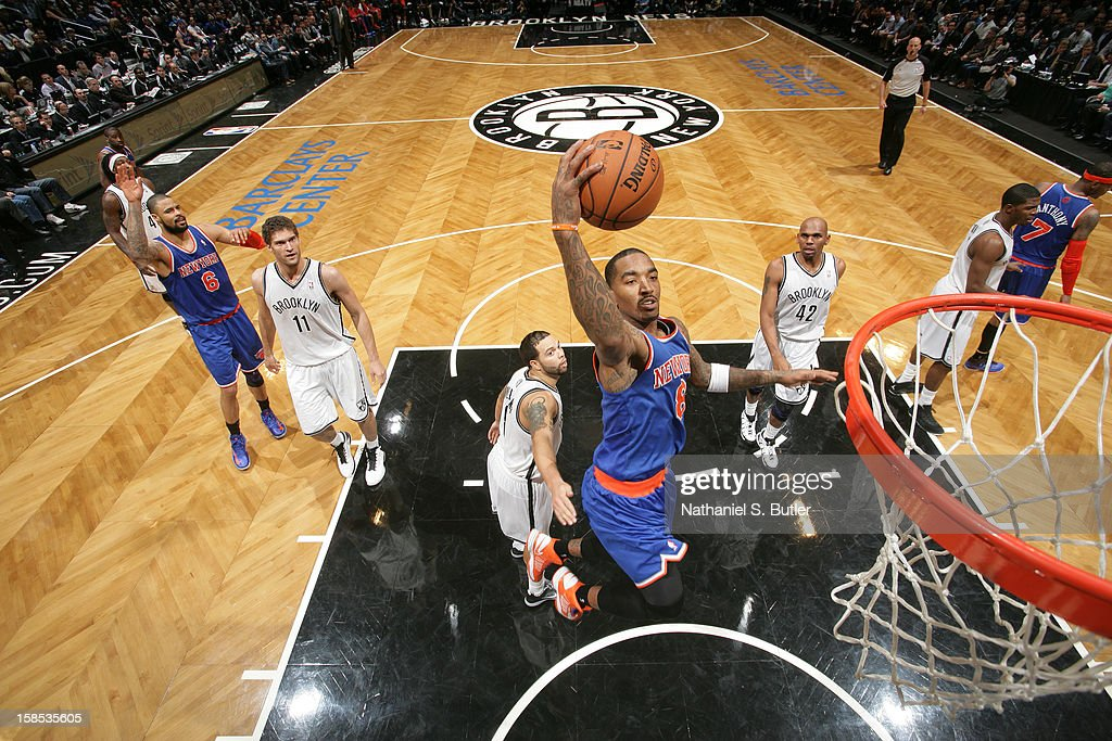 J.R. Smith #8 of the New York Knicks dunks the ball against the Brooklyn Nets on November 26, 2012 at the Barclays Center in the Brooklyn Borough of New York City.