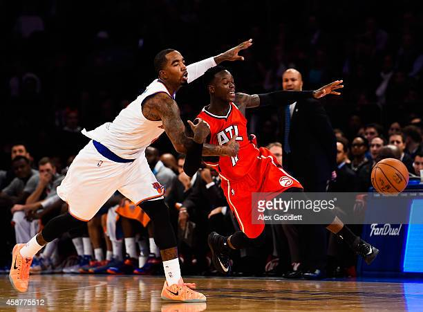R Smith of the New York Knicks guards Dennis Schroder of the Atlanta Hawks in the second half at Madison Square Garden on November 10 2014 in New...
