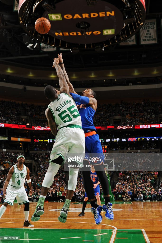 J.R. Smith #8 of the New York Knicks puts up a shot against Terrence Williams #55 of the Boston Celticson March 26, 2013 at the TD Garden in Boston, Massachusetts.