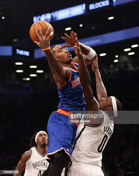 Smith of the New York Knicks scores two past Andray Blatche of the Brooklyn Nets at the Barclays Center on November 26, 2012 in the Brooklyn borough...