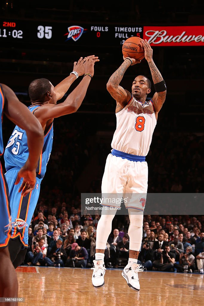 J.R. Smith #8 of the New York Knicks shoots against Kevin Durant #35 of the Oklahoma City Thunder on March 7, 2013 at Madison Square Garden in New York City.