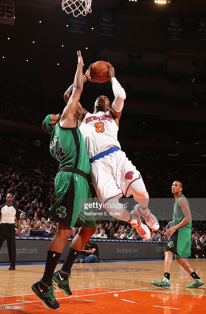 J.R. Smith #8 of the New York Knicks shoots against Paul Pierce #34 of the Boston Celtics on March 31, 2013 at Madison Square Garden in New York City.