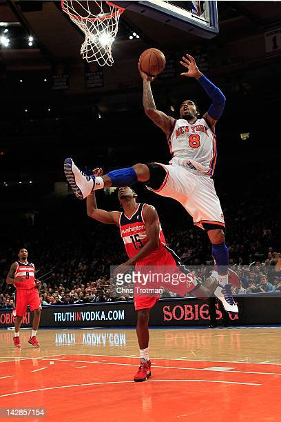 R Smith of the New York Knicks shoots over Jordan Crawford of the Washington Wizards at Madison Square Garden on April 13 2012 in New York City NOTE...