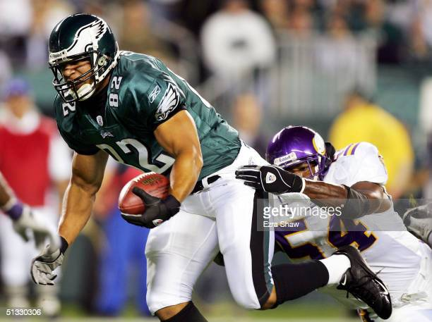 Smith of the Philadelphia Eagles breaks away from Dontarrious Thomas of the Minnesota Vikings to score a touchdown in the first period at Lincoln...