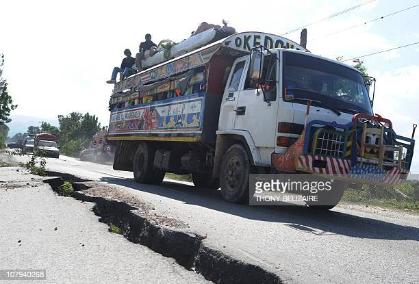 SMITHHaitians drive pass the earthquake hit road January 8 2011 in Leogane 30 Km from PortauPrince Leogane is the epicentre of January 12 2010...