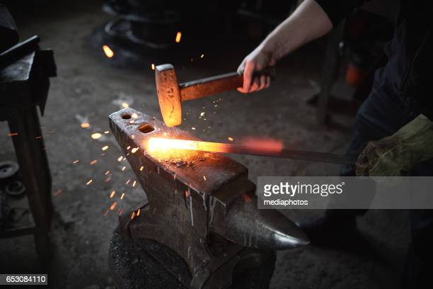 smithing process - blacksmith shop stock photos and pictures