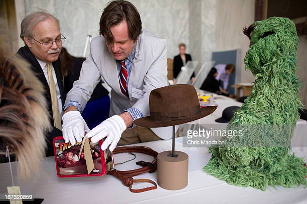Smithsonian National Museum of American History curators Dwight Bowers and Eric Jentsch help set up props from the Indiana Jones movies and Sesame...