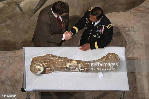 Smithsonian National Museum of Natural History Director Kirk Johnson and US Army Corps of Engineers Lt Gen Thomas Bostick look shake hands after...