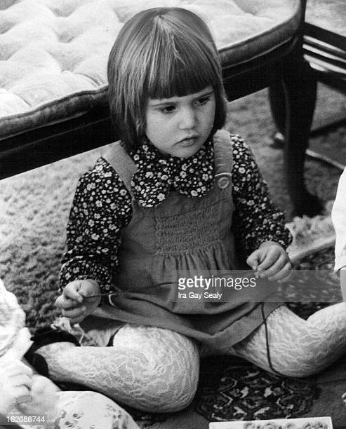 DEC 2 1975 DEC 19 1975 DEC 28 1975 Smocking details the front of Stephanie Babich's green jumper worn with tiny floral print shirt lacy panty hose