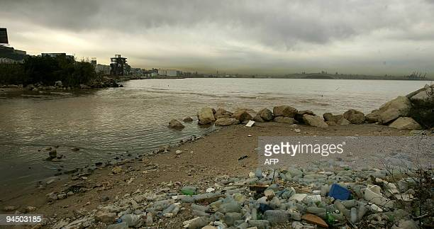 Smog covers the skyline of Beirut while empty plastic bottles and trash pollute the shore of the Mediterranean off Dbayeh as suburb of the Lebanese...