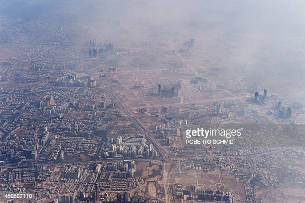 Smog envelops buildings on the outskirts of the Indian capital New Delhi on November 25 2014 AFP PHOTO/Roberto SCHMIDT