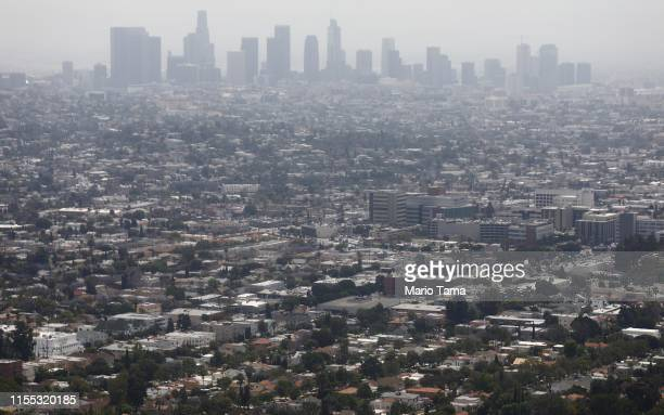 Smog hangs over the city on a day rated as having 'moderate' air quality in downtown Los Angeles, on June 11, 2019 in Los Angeles, California....