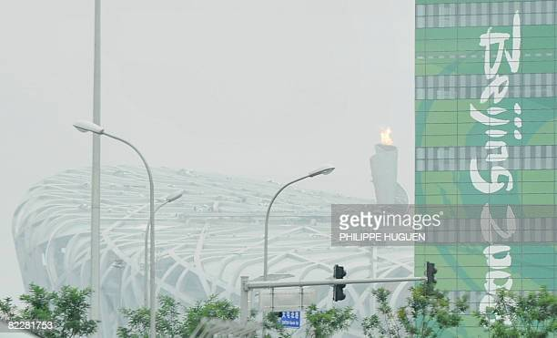 Smog is pictured over the National Stadium or 'Birds Nest' in Beijing on August 13 on day 5 of the 2008 Beijing Olympic Games. China erupted...