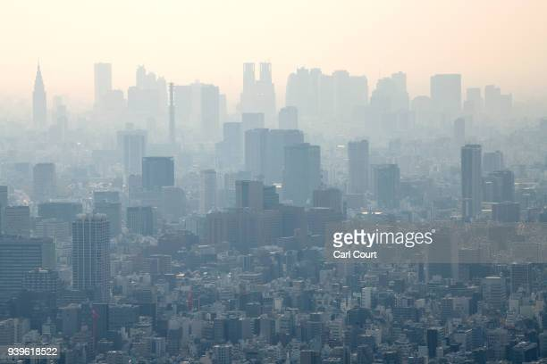 Smog is seen over the Tokyo skyline from the viewing platform of the Tokyo Skytree on March 29, 2018 in Tokyo, Japan. The tower was opened to the...