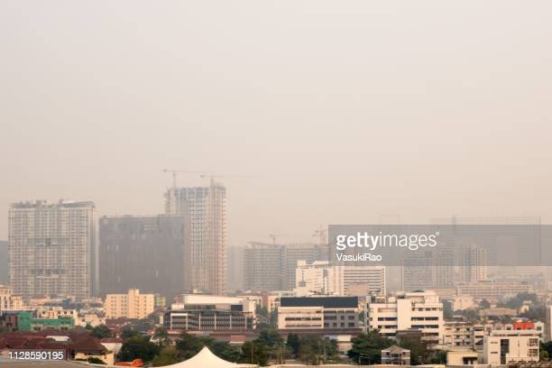 smog over bangkok, thailand - smog stock pictures, royalty-free photos & images