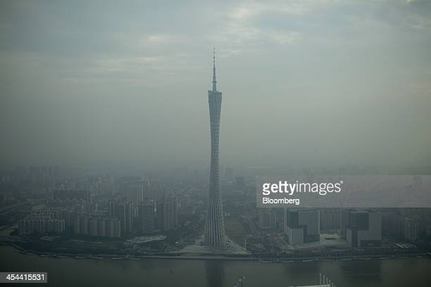 Smog surrounds the Canton Tower in Guangzhou Guangdong province China on Wednesday Nov 20 2013 China's government may set its 2014 growth target at 7...