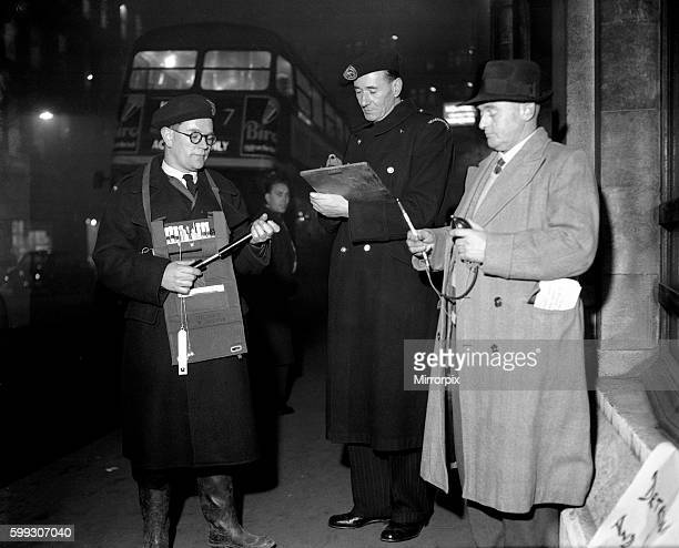 Smog Wardens in action on the streets of London, 5th January 1956.