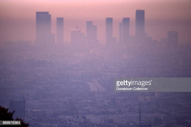 A smoggy aerial view of the cityscape and downtown skyline in January 1975 in Los Angeles California