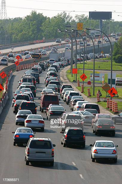 smoggy traffic on highway in construction - buzbuzzer stock pictures, royalty-free photos & images