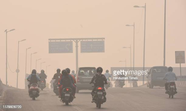 A smoggy view in the morning of traffic moving near Geeta Colony on November 4 2019 in New Delhi India Though the air quality index was still in the...
