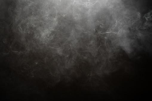 Smoke against black background 1143001747