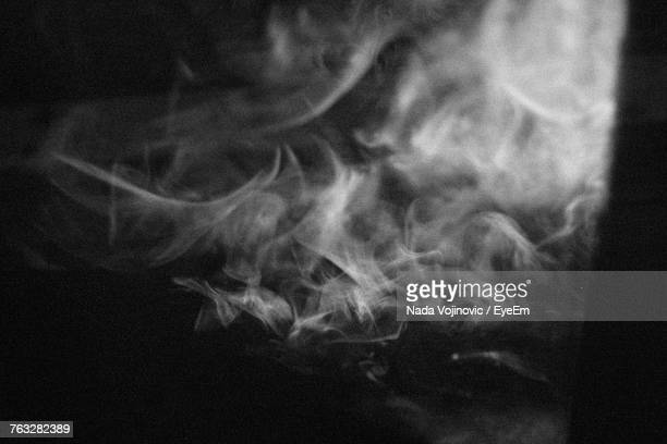 smoke against black background - smoke physical structure stock pictures, royalty-free photos & images