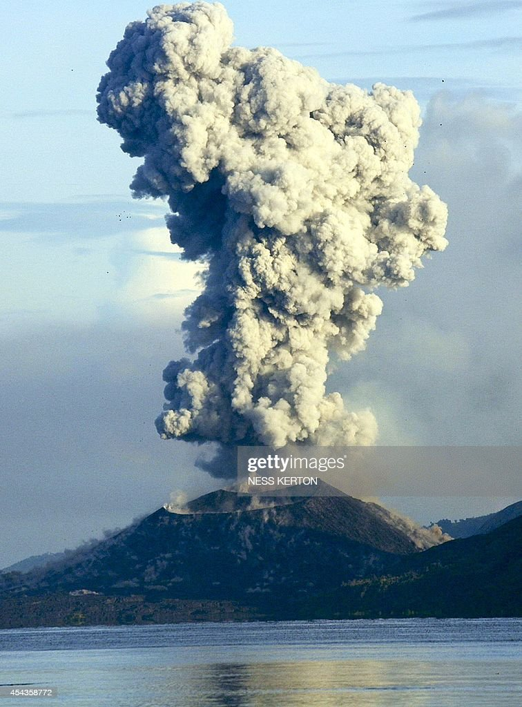Smoke and ash fills the air as Mount Tavurvur erupts in Rabaul in eastern Papua New Guinea on August 30, 2014. A volcano which has erupted in Papua New Guinea was on August 30 spewing fragments from its crater and rumbling loudly, but its activity appeared to be subsiding, a seismologist said. Mount Tavurvur, which destroyed the town of Rabaul when it erupted simultaneously with nearby Mount Vulcan in 1994, came to life again early Friday, with rocks and ash erupting from its centre.