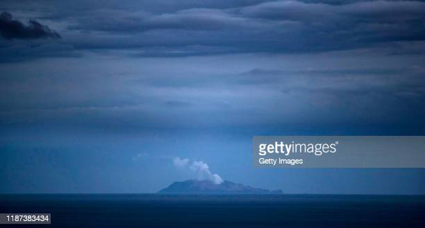 Smoke and ash rises from a volcano on White Island early in the morning on December 10 2019 in Whakatane New Zealand Five people are confirmed dead...