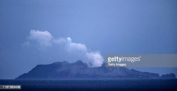Smoke and ash rises from a volcano on White Island early in the morning on December 10, 2019 in Whakatane, New Zealand. Five people are confirmed...