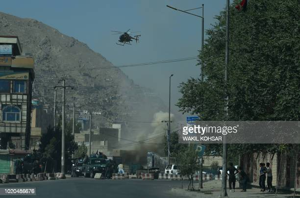 TOPSHOT Smoke and dust rise following an air strike from an Afghan military helicopter during ongoing clashes between Afghan security forces and...