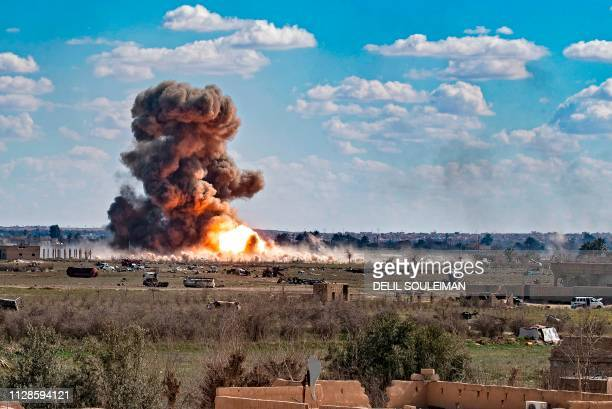 Smoke and fire billow after shelling on the Islamic State group's last holdout of Baghouz, in the eastern Syrian Deir Ezzor province on March 3,...
