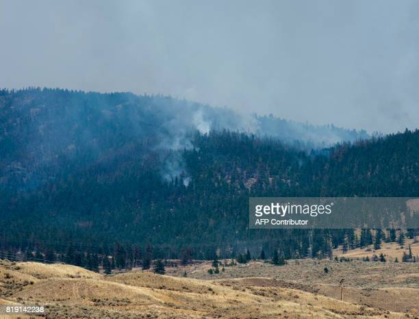 Smoke and fire fill the air July 19 2017 in and around Cache Creek as forest fires rage in western Canada The provincial government extended a state...